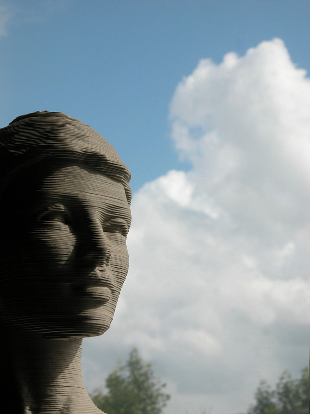 sculpture and clouds